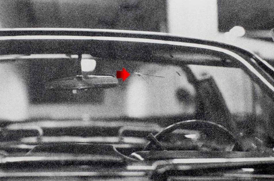 Bullet hol in front windshield of JFK limousine
