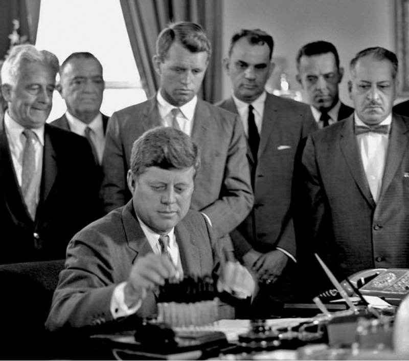 28 JFK signs senate bill to combat organized crime